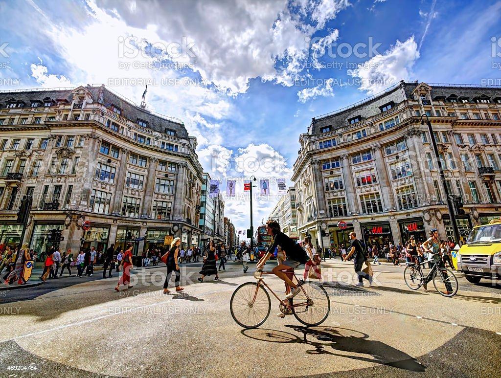Cycling through Oxford Circus stock photo