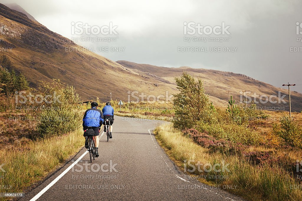 Cycling through the Highlands stock photo