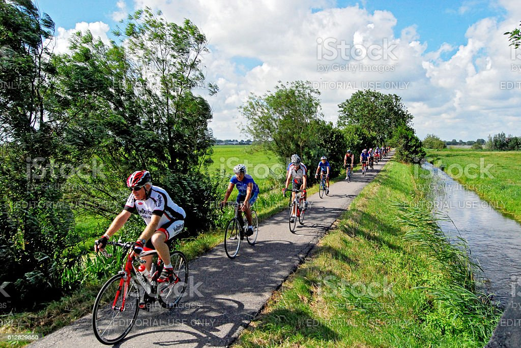 Cycling through the polder stock photo