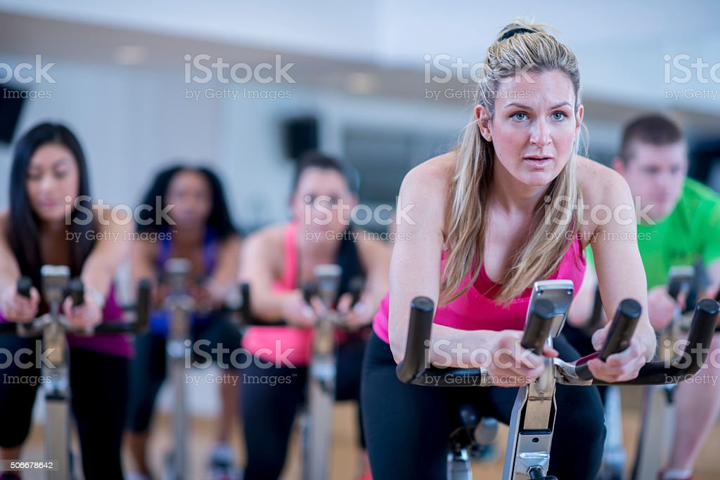 Cycling Together in Spin Class stock photo