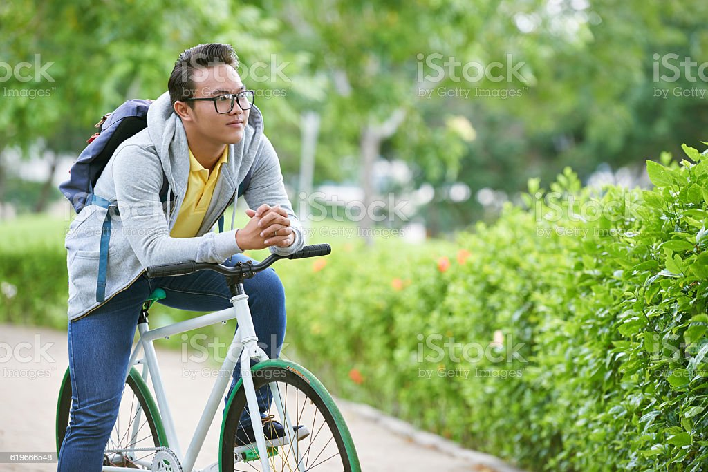 Cycling young man stock photo