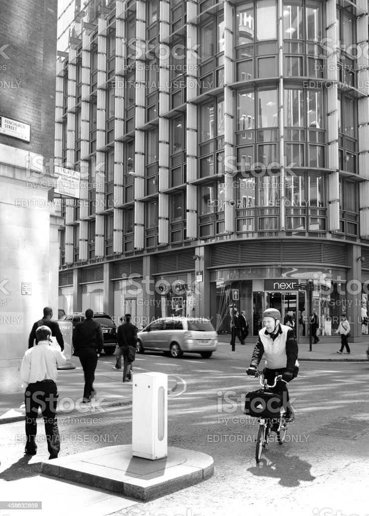 Cyclist and pedestrians in financial district of London royalty-free stock photo