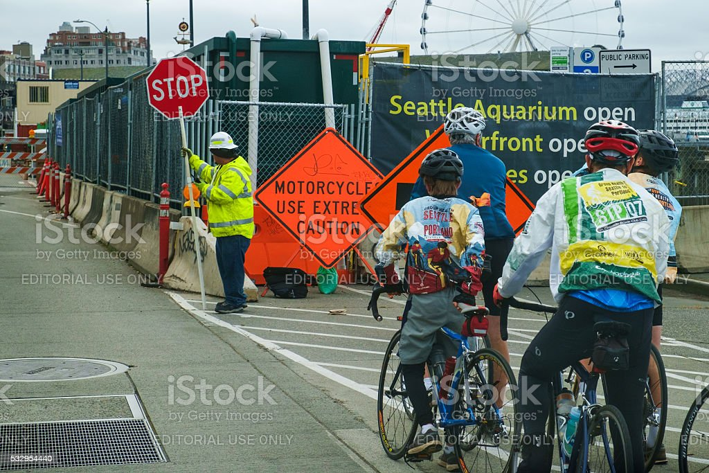 Cyclist and road construction stock photo