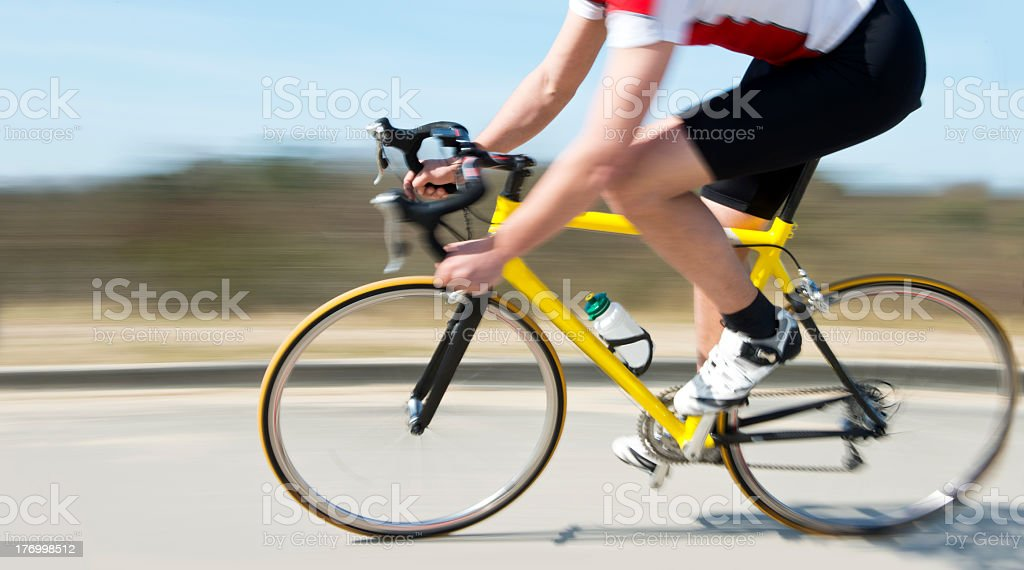 Cyclist at speed stock photo