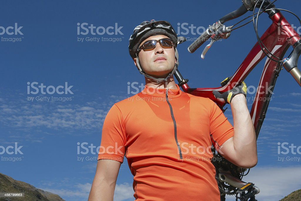 Cyclist Carrying Bike stock photo