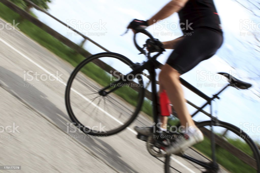 Cyclist climbing, blurred motion. royalty-free stock photo