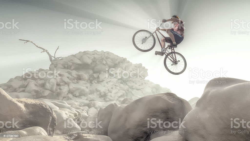 Cyclist climbing on a rock. stock photo