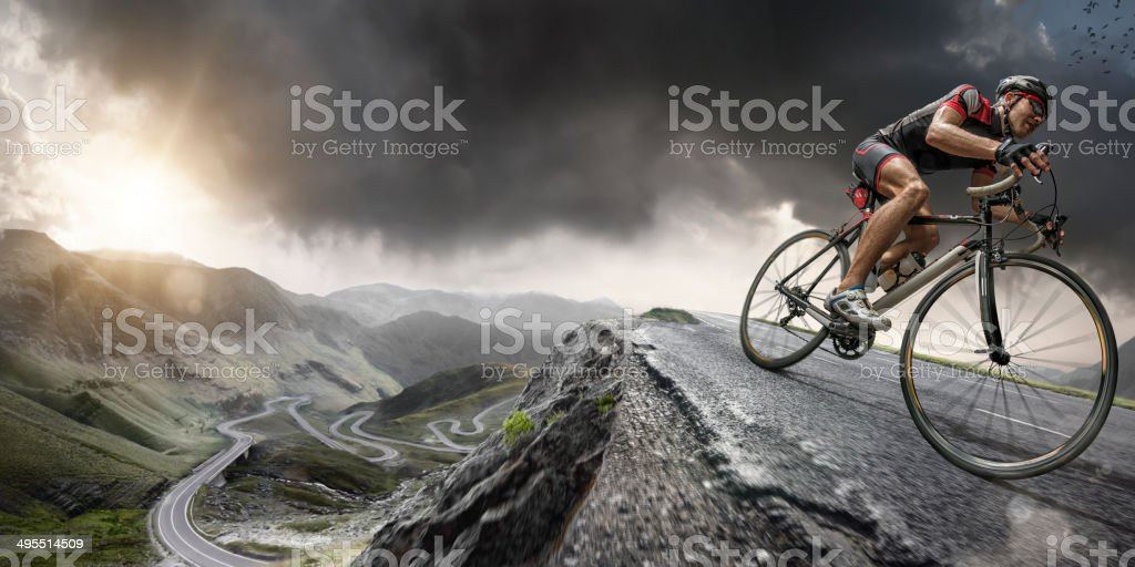 Cyclist Climbs To The Top royalty-free stock photo