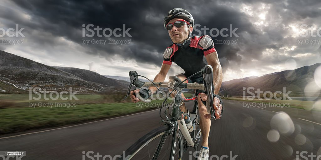 Cyclist Coming Home After Hard Ride stock photo