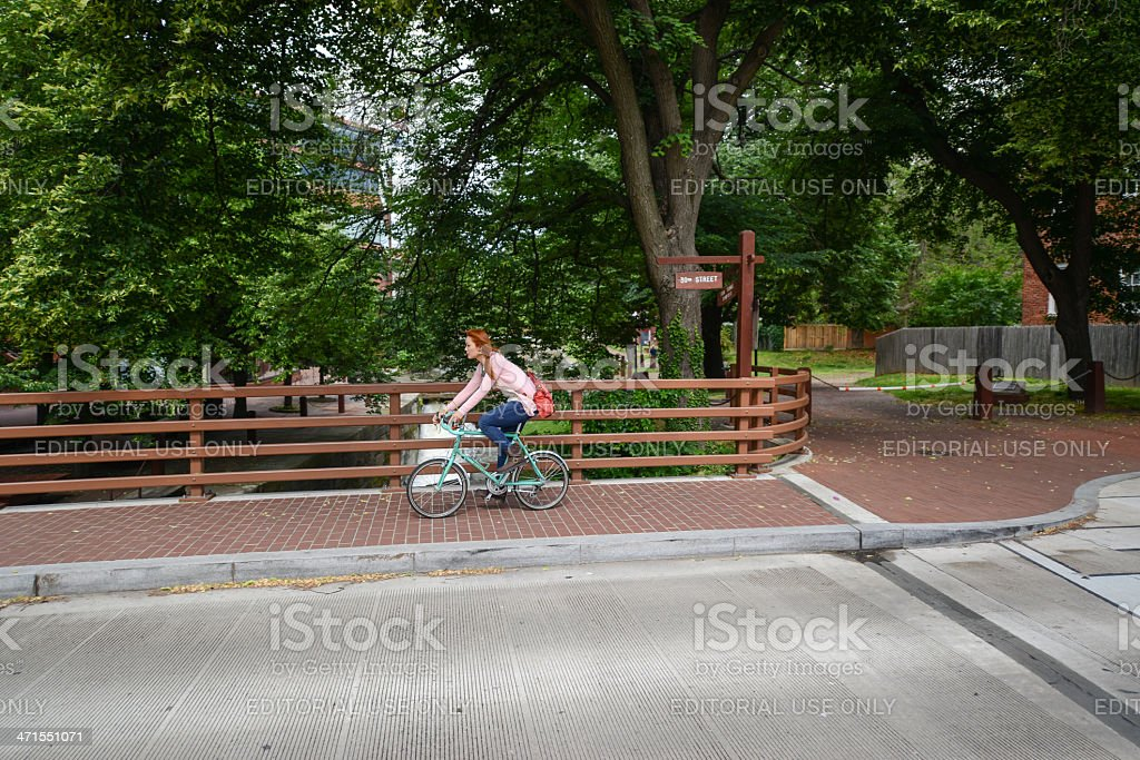 Cyclist Crosses the C and O Canal - Georgetown stock photo