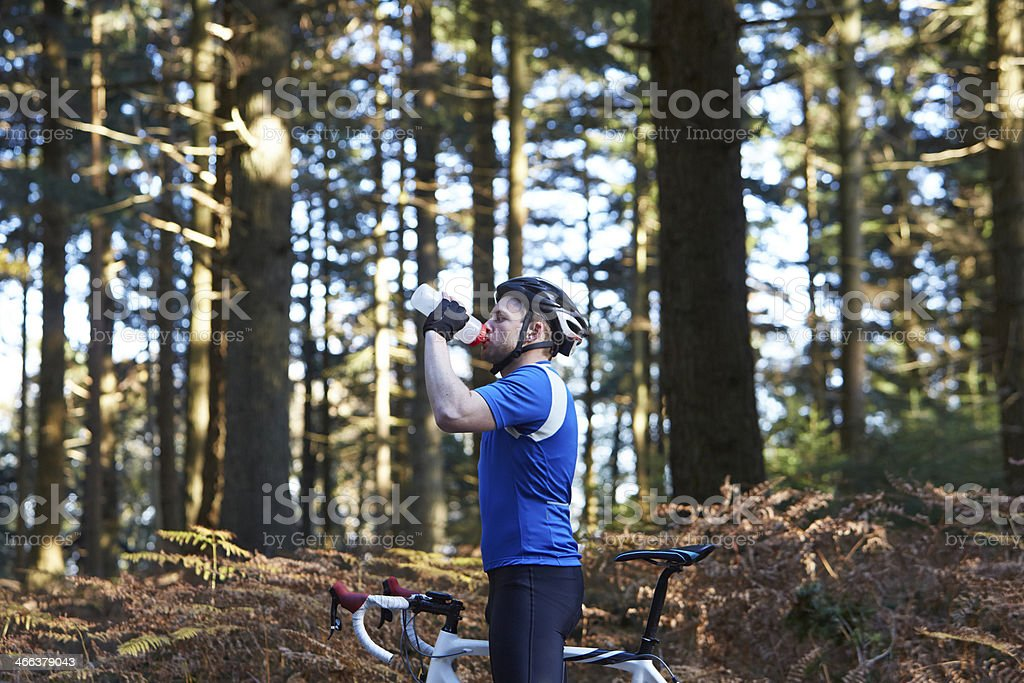 Cyclist drinking whilst cycling stock photo