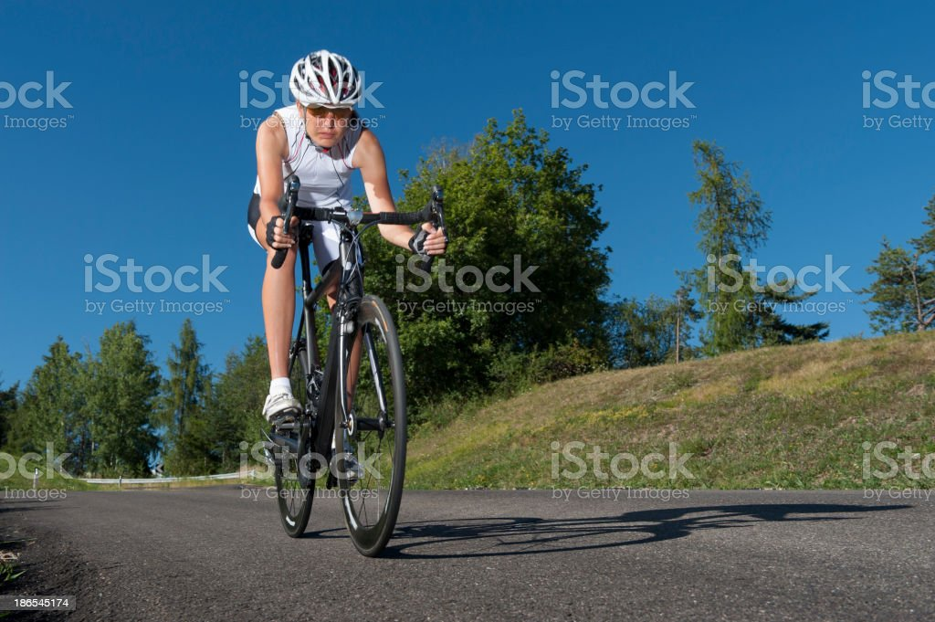 cyclist driving through a curve stock photo