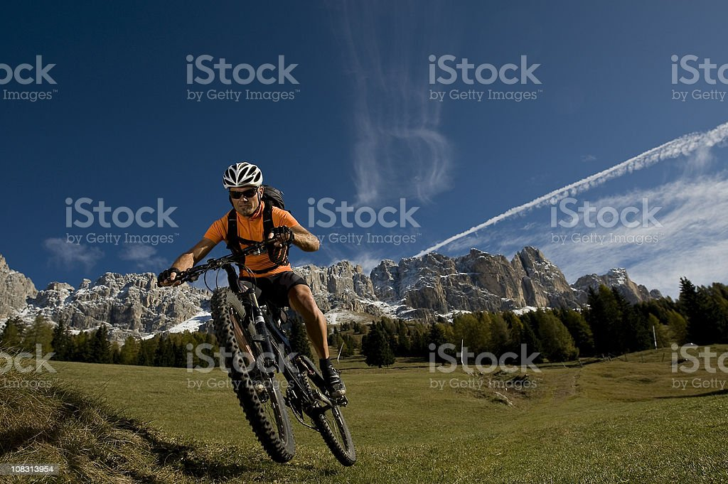 Cyclist enjoys nature in the Dolomites royalty-free stock photo