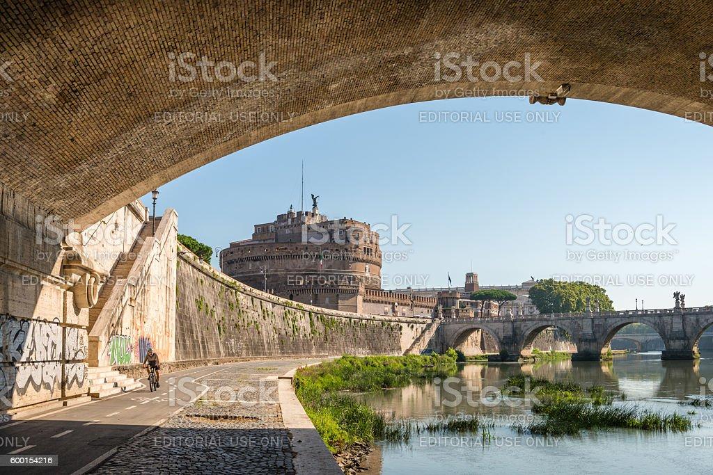 Cyclist has a ride alongside River Tiber stock photo
