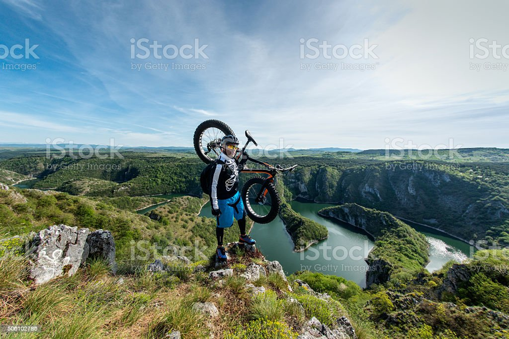 Cyclist holding his fat bike stock photo