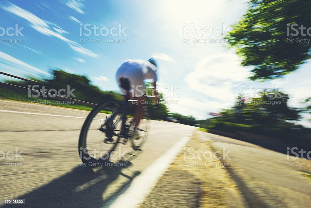 Cyclist in a Country Road stock photo