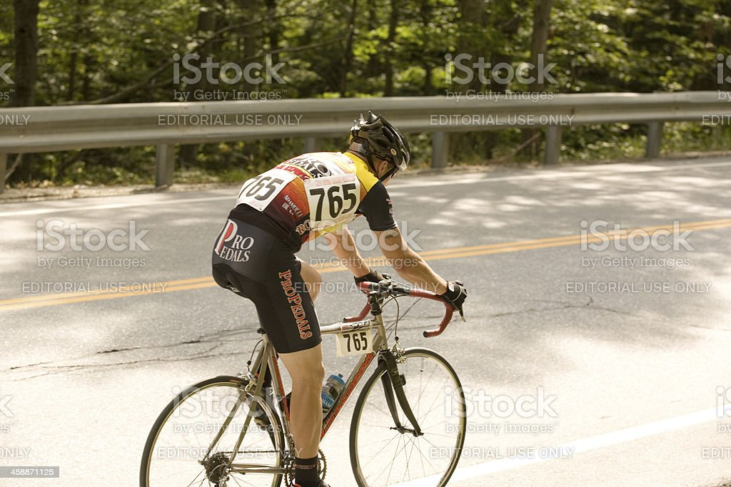 Cyclist in a Pro-Am Road Race royalty-free stock photo