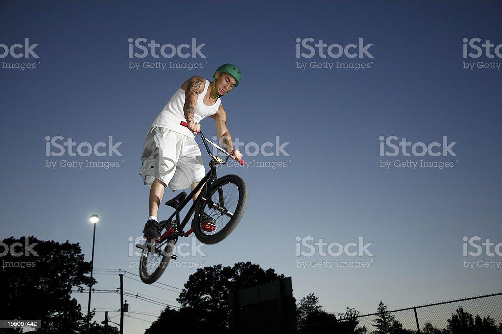 BMX Cyclist In Dusk Sky royalty-free stock photo