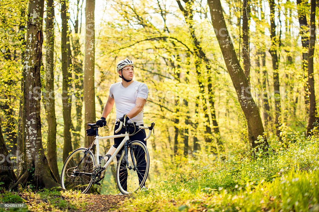 Cyclist in forest stock photo