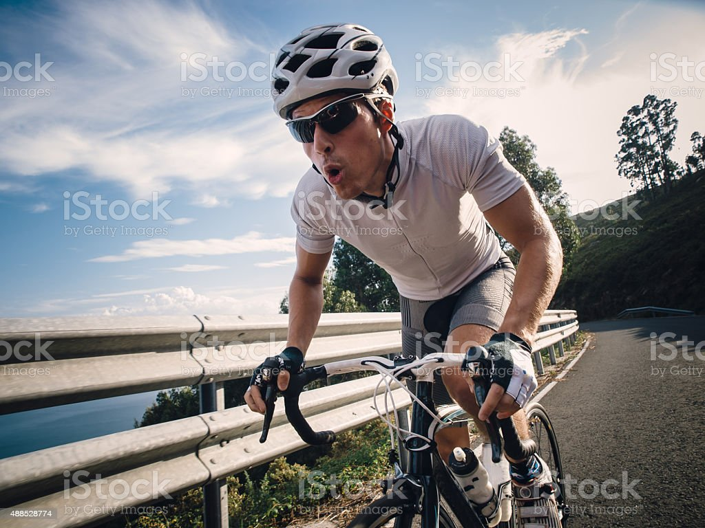 Cyclist in maximum effort on a road stock photo