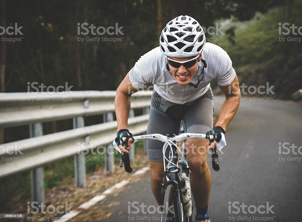 Cyclist in maximum effort stock photo