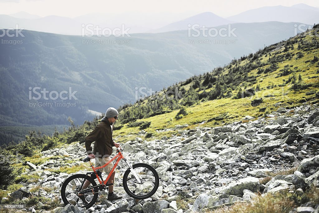 Cyclist in mountains stock photo
