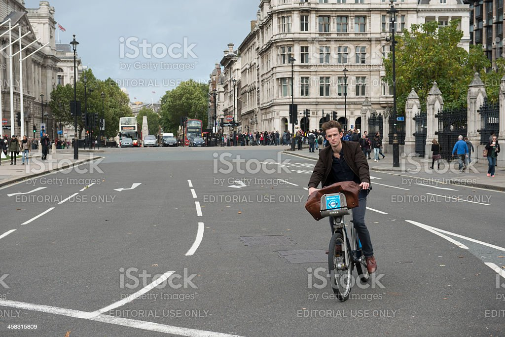 Cyclist in Parliament Square London stock photo