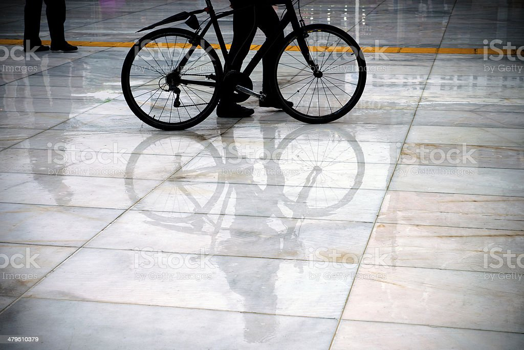 Cyclist in rain royalty-free stock photo