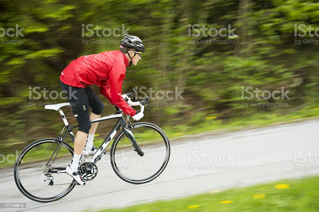 Cyclist in red shirt practicing stock photo