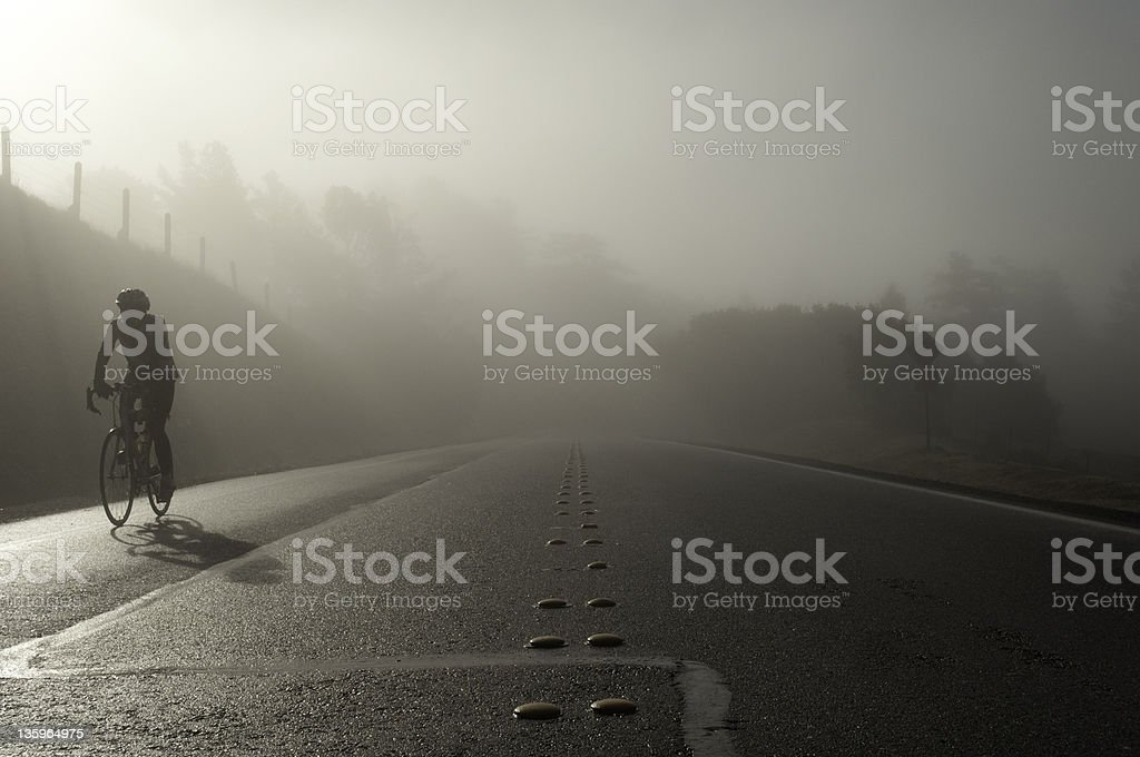 Cyclist in the Fog stock photo