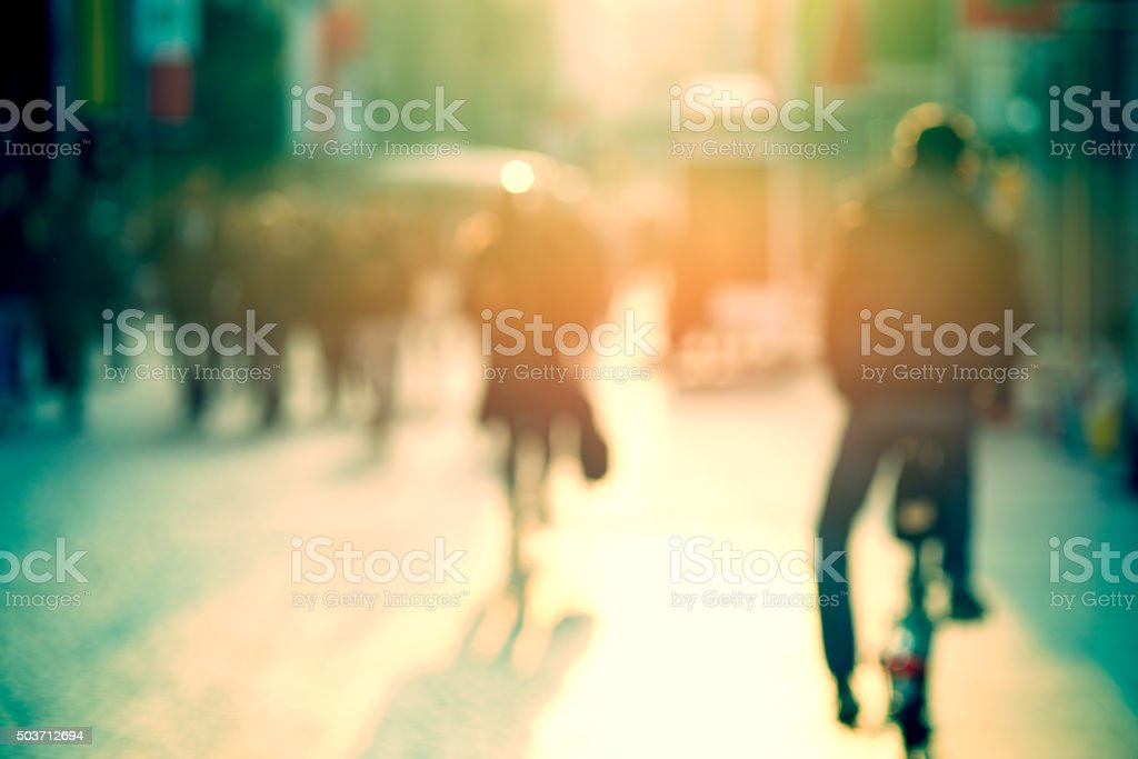 cyclist in the street, blurry stock photo