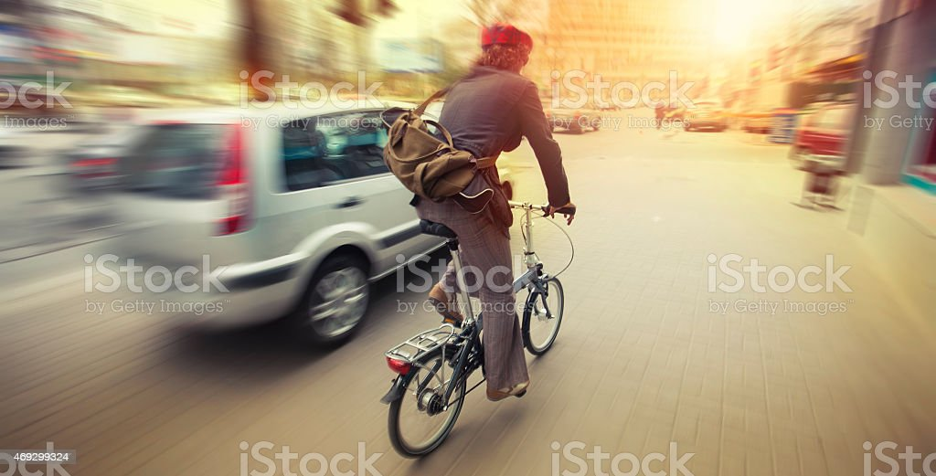 cyclist in traffic on the city roadway motion blur stock photo