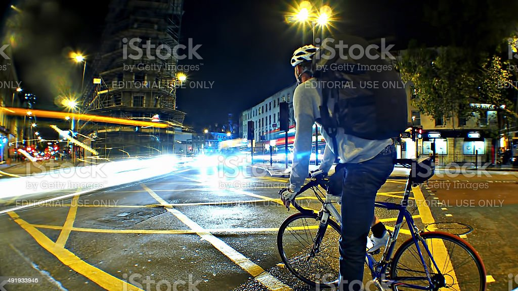 Cyclist in traffic stock photo