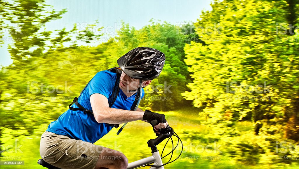 Cyclist looking back stock photo