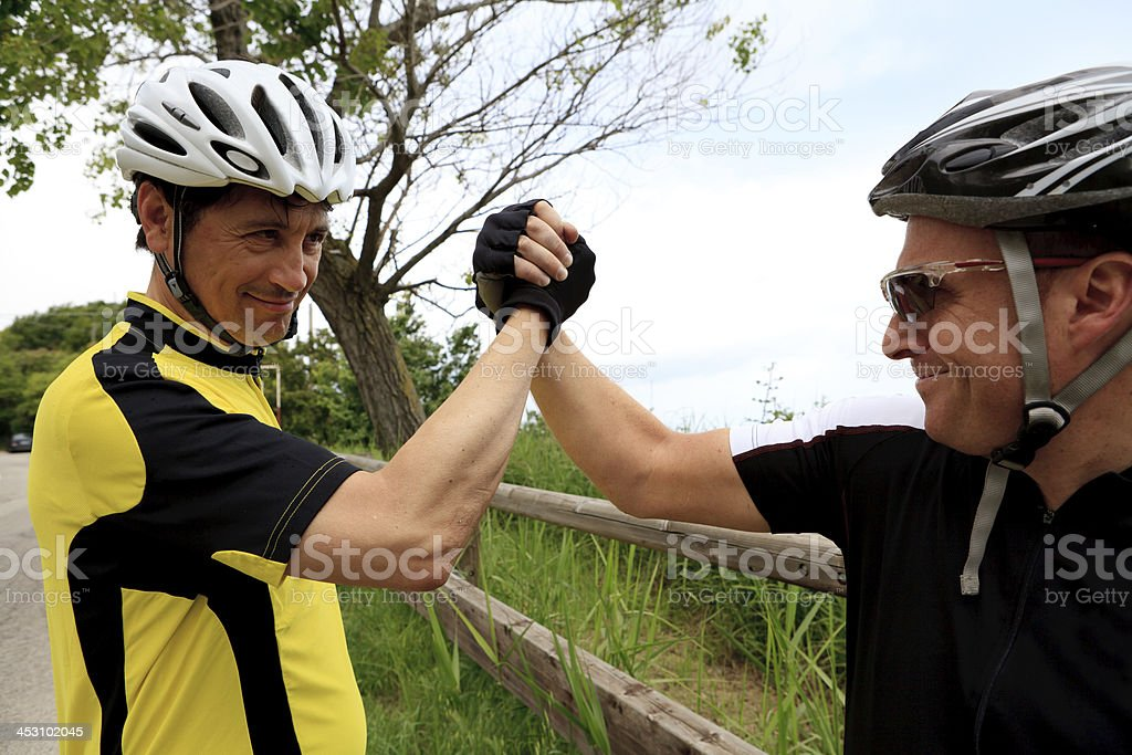 cyclist making a deal royalty-free stock photo