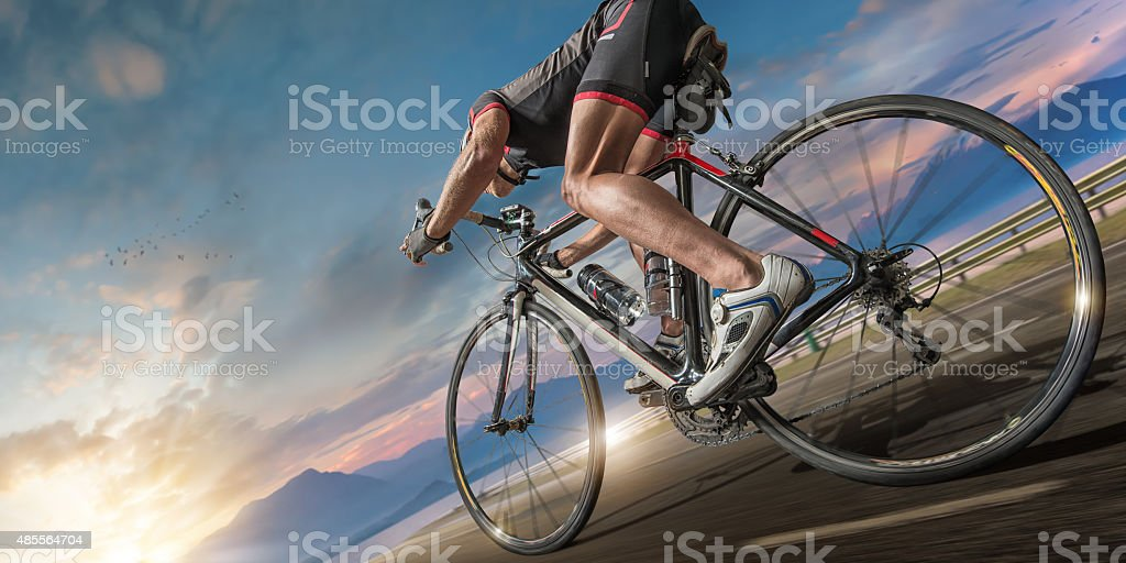 Cyclist Moving Fast On Coastal Path stock photo