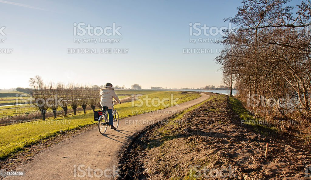 Cyclist on a polder dike stock photo