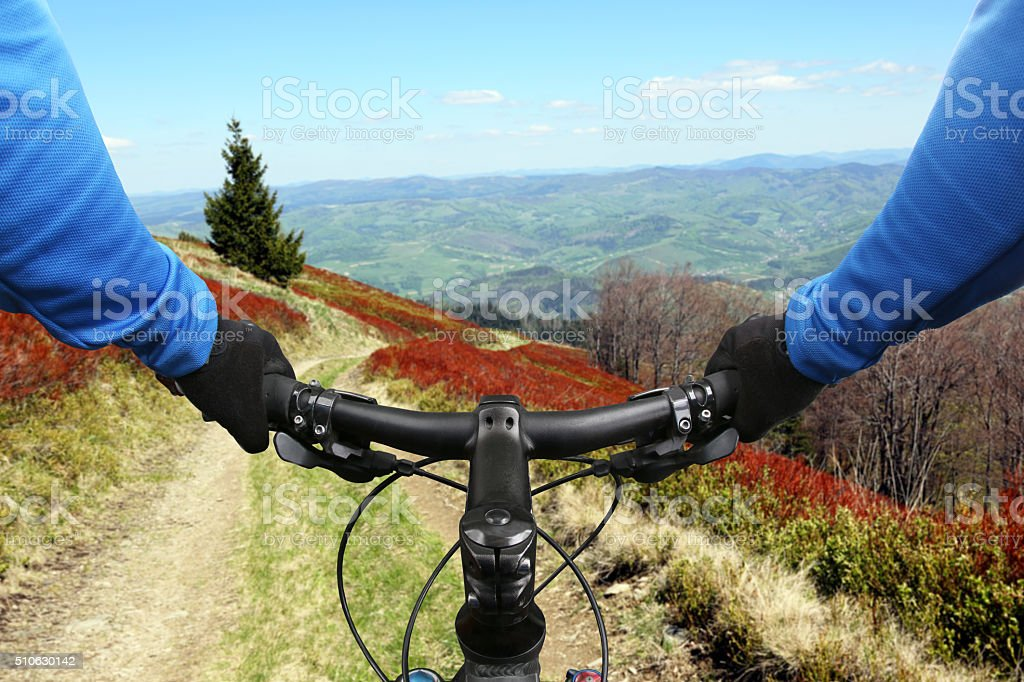 cyclist on bike rides on a mountain road stock photo