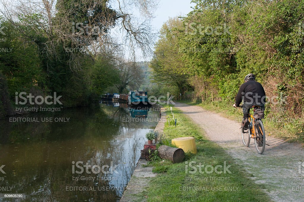 Cyclist on canal towpath stock photo