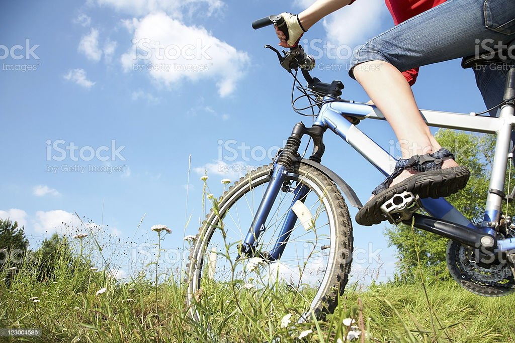 cyclist on green grass royalty-free stock photo