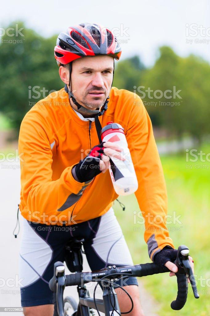 Cyclist on race bike pedaling on bike track stock photo