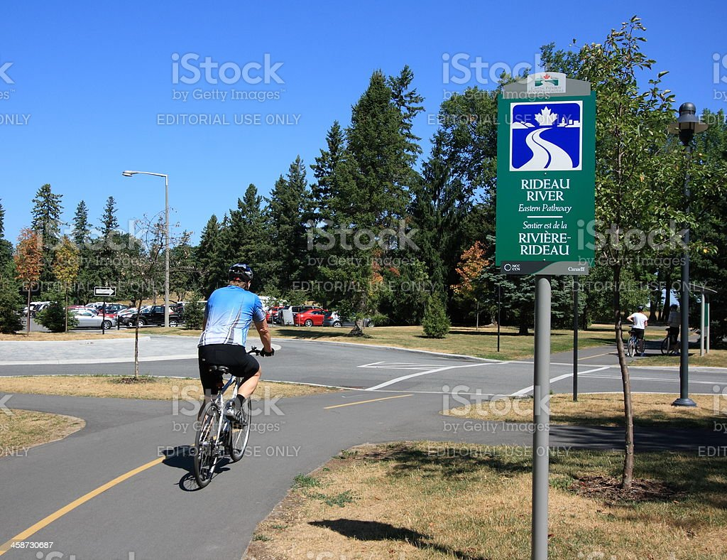 Cyclist on Rideau River Pathway stock photo