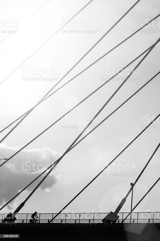 cyclist on the bridge stock photo