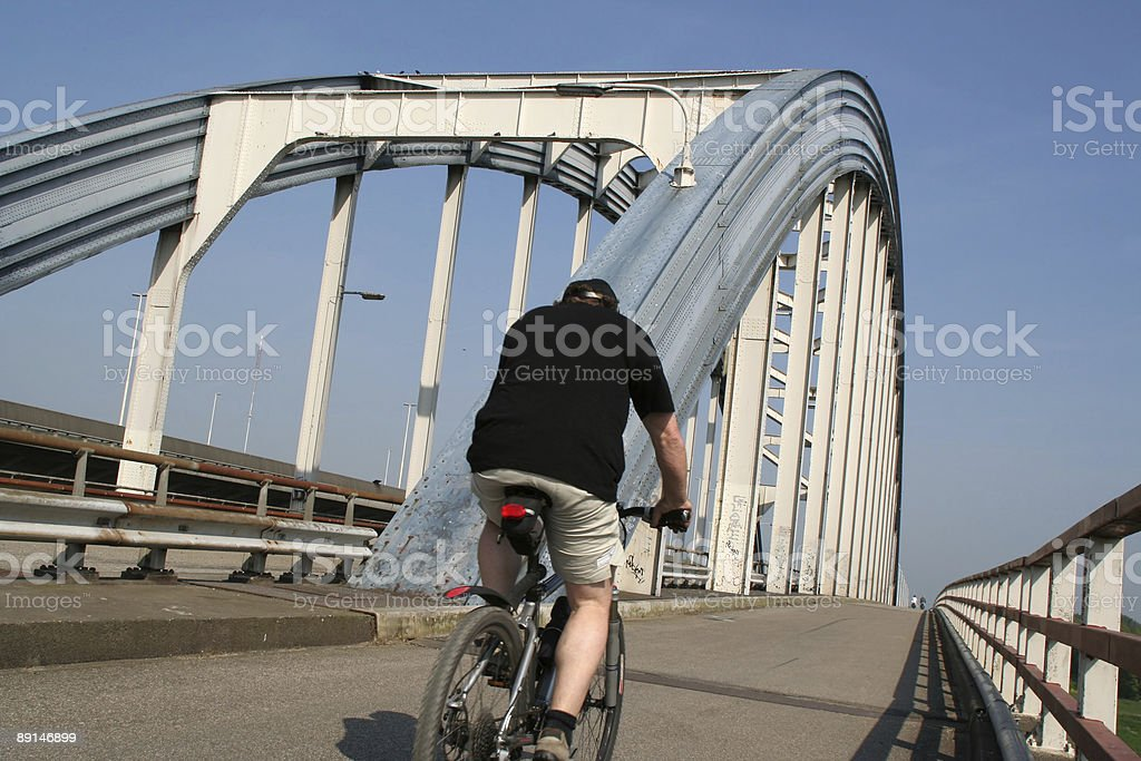 Cyclist on the bridge royalty-free stock photo