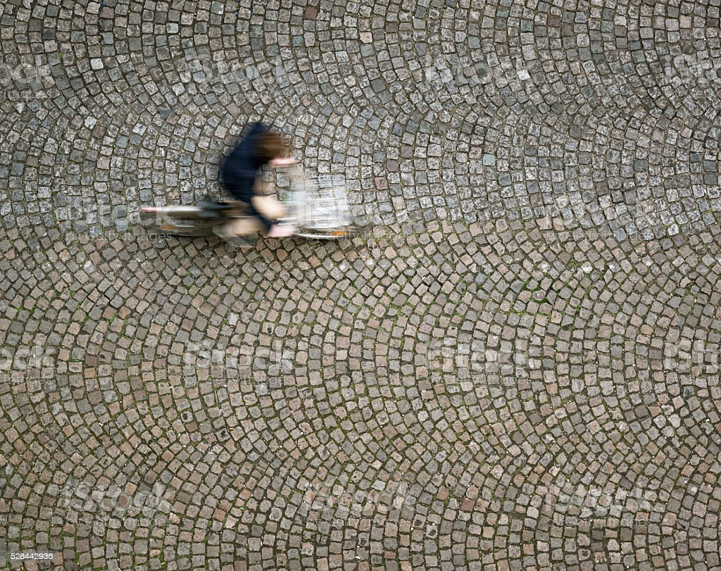 Cyclist on the move, photographed from directly above stock photo