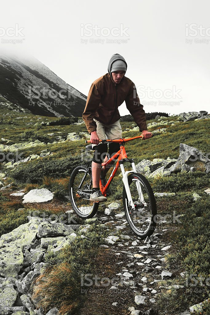 Cyclist on the peak. stock photo