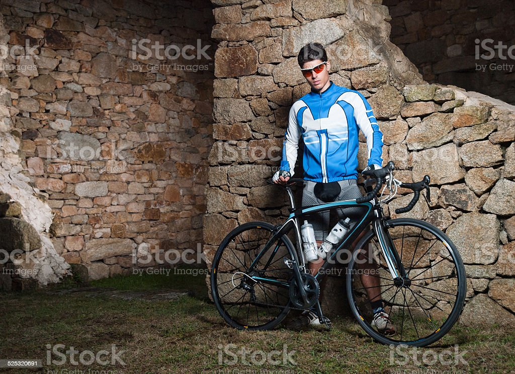 Cyclist posing with his racing bike stock photo