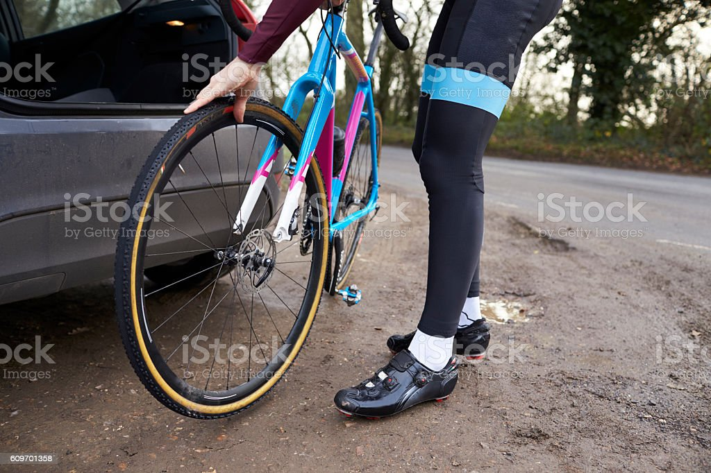 Cyclist preparing his bike for a ride, low section crop stock photo