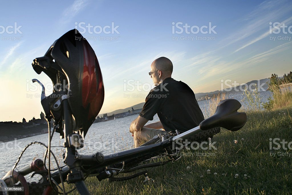 Cyclist relaxing during sunset royalty-free stock photo