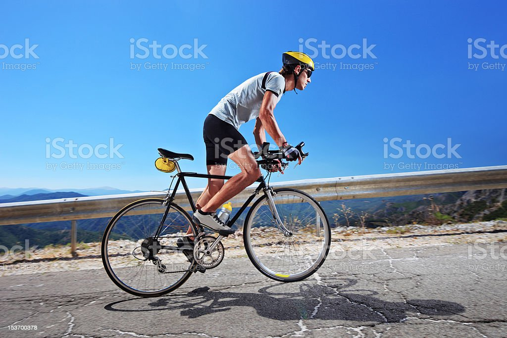 Cyclist riding a bike uphill royalty-free stock photo